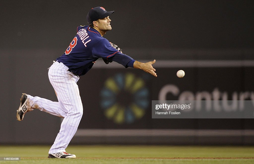 <a gi-track='captionPersonalityLinkClicked' href=/galleries/search?phrase=Jamey+Carroll+-+Baseball+Player&family=editorial&specificpeople=211176 ng-click='$event.stopPropagation()'>Jamey Carroll</a> #8 of the Minnesota Twins throws to first for the final out against the Philadelphia Phillies on June 12, 2012 at Target Field in Minneapolis, Minnesota. The Twins defeated the Phillies 11-7.