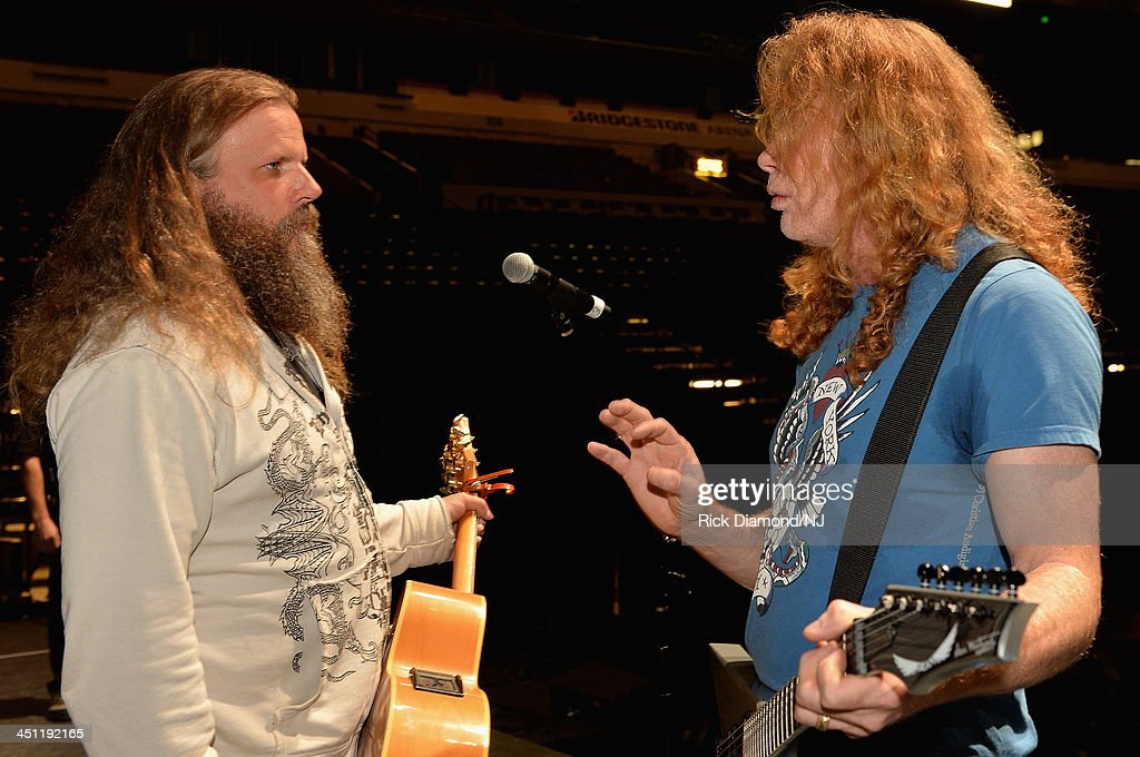 Jamey Johnson and Dave Mustaine speak during rehearsals of Playin' Possum! The Final No Show Tribute To George Jones at Bridgestone Arena on November 21, 2013 in Nashville, Tennessee.