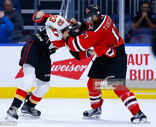 Jamey Lauzon of the Baie Comeau Drakkar and Yanick Turcotte of the Quebec Remparts fight during their QMJHL hockey game at the Centre Videotron on...