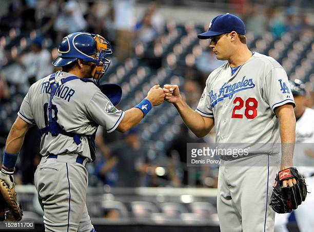 Jamey Wright of the Los Angeles Dodgers right is congratulated by Matt Treanor after getting the final out in the ninth inning of a baseball game...
