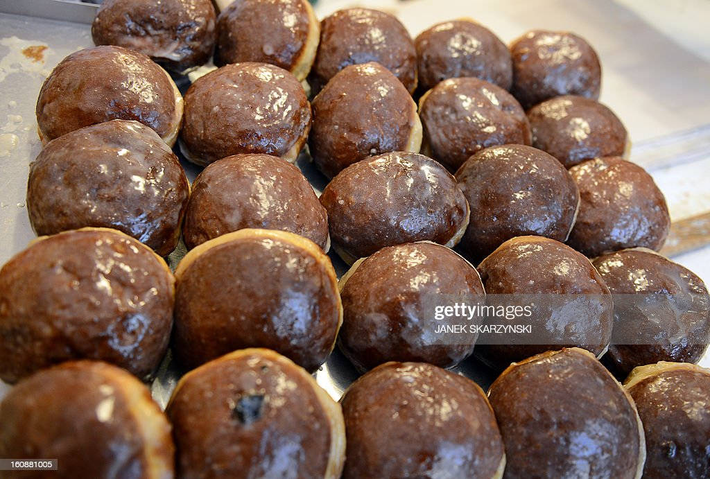 Jam-filled Paczki doughnuts are on sale in a popular sweet shop in Warsaw on Fat Thursday on February 7, 2013.