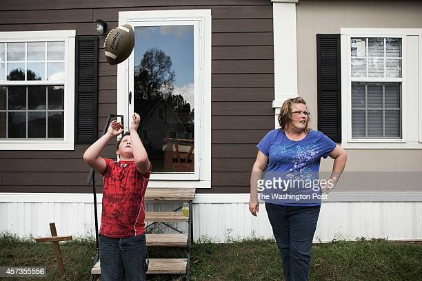 Jamie Abbott watches her son Brody play football in the yard In February 2014 the Abbott family purchased a sofa set fromBuddy's Home Furnishings a...