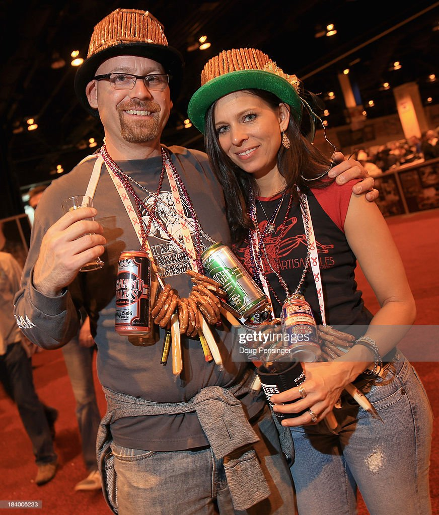 Jamie and Kristen Sandrovich of Colorado Springs, Colorado attend the 32nd annual Great American Beer Festival at the Colorado Convention Center on October 10, 2013 in Denver, Colorado. The GABF runs October 10-12 and 49,000 attendees will be offered 3100 beers from 624 breweries.