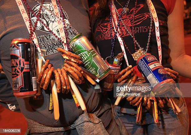 Jamie and Kristen Sandrovich of Colorado Springs Colorado wear their snacks around their necks as they attend the 32nd annual Great American Beer...