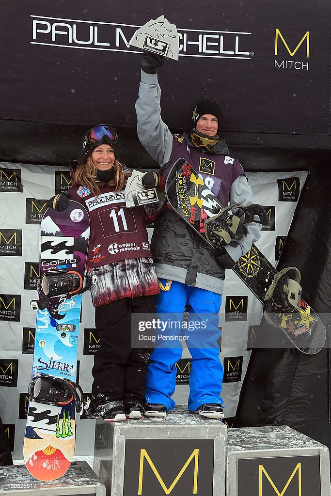 Jamie Anderson and Charles Guldemond ladies and men's US National Snowboard Slope Style Champions respectively, take the podium after they each won the FIS Snowboard Slope Style World Cup at the US Grand Prix on January 11, 2013 in Copper Mountain, Colorado.