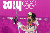 Jamie Anderson of the United States celebrates after receiving her score in the Women's Snowboard Slopestyle Finals during day two of the Sochi 2014...