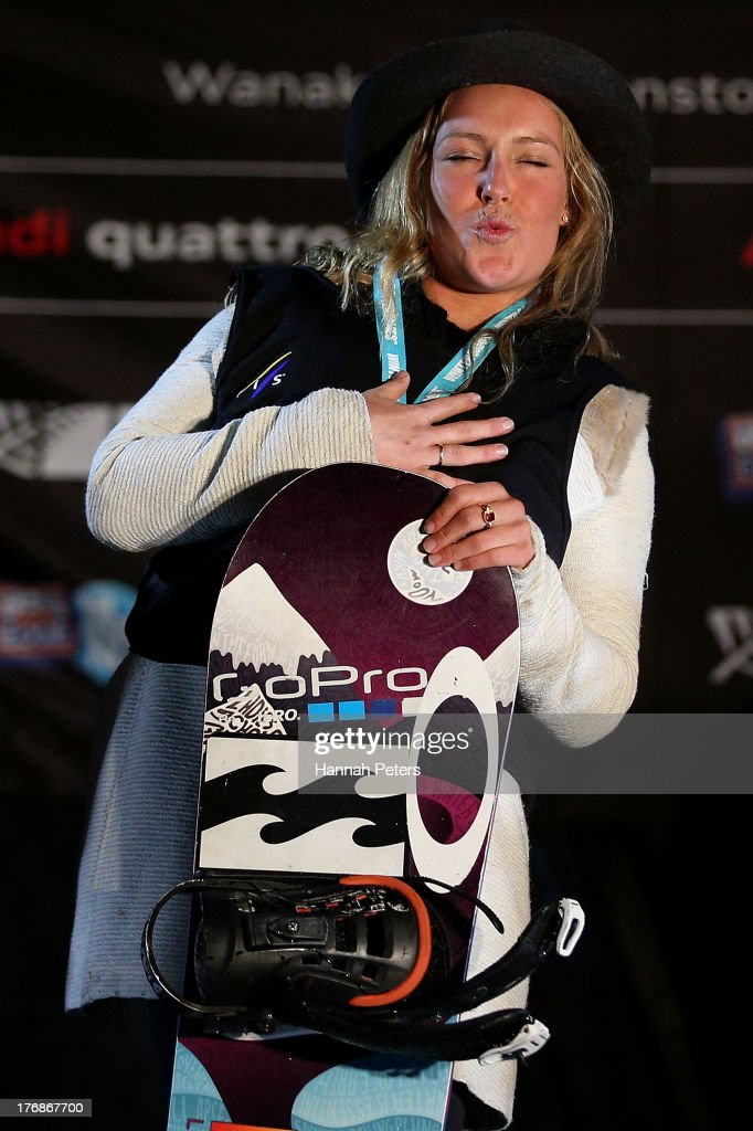 Jamie Anderson of the USA celebrates on the podium after winning the FIS Snowboard Slopestyle World Cup Finals during day five of the Winter Games NZ on August 19, 2013 in Wanaka, New Zealand.