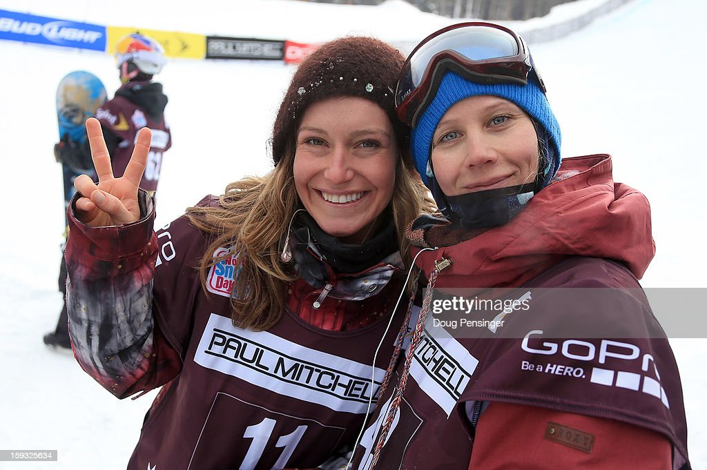 Jamie Anderson of the USA in first place and Kjersti Buaas of Norway in second place celebrate their finishes in the ladies FIS Snowboard Slope Style World Cup at the US Grand Prix on January 11, 2013 in Copper Mountain, Colorado.