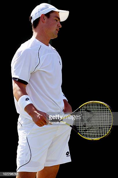 Jamie Baker of Great Britain in action during the first round match against Andreas Beck of Germany on Day Two of the Wimbledon Lawn Tennis...