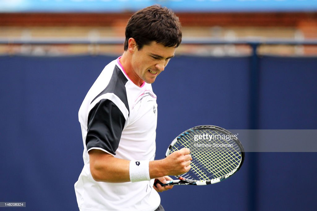 <a gi-track='captionPersonalityLinkClicked' href=/galleries/search?phrase=Jamie+Baker&family=editorial&specificpeople=583109 ng-click='$event.stopPropagation()'>Jamie Baker</a> of Great Britain reacts to a play during his first round match against Oliver Golding of Great Britain on day two of the AEGON Championships at Queens Club on June 12, 2012 in London, England.