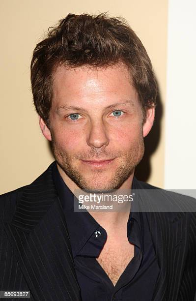 Jamie Bamber poses at Jameson Empire Awards Press Room at Grosvenor House Hotel on March 29 2009 in London England