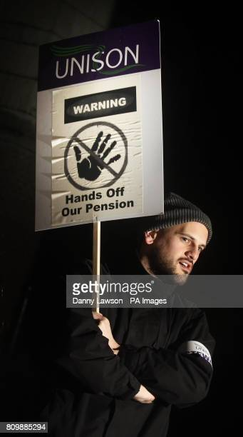 Jamie Beaumont stands on a picket line outside the Western Infirmary in Glasgow as 300000 public sector workers walk out across Scotland in biggest...