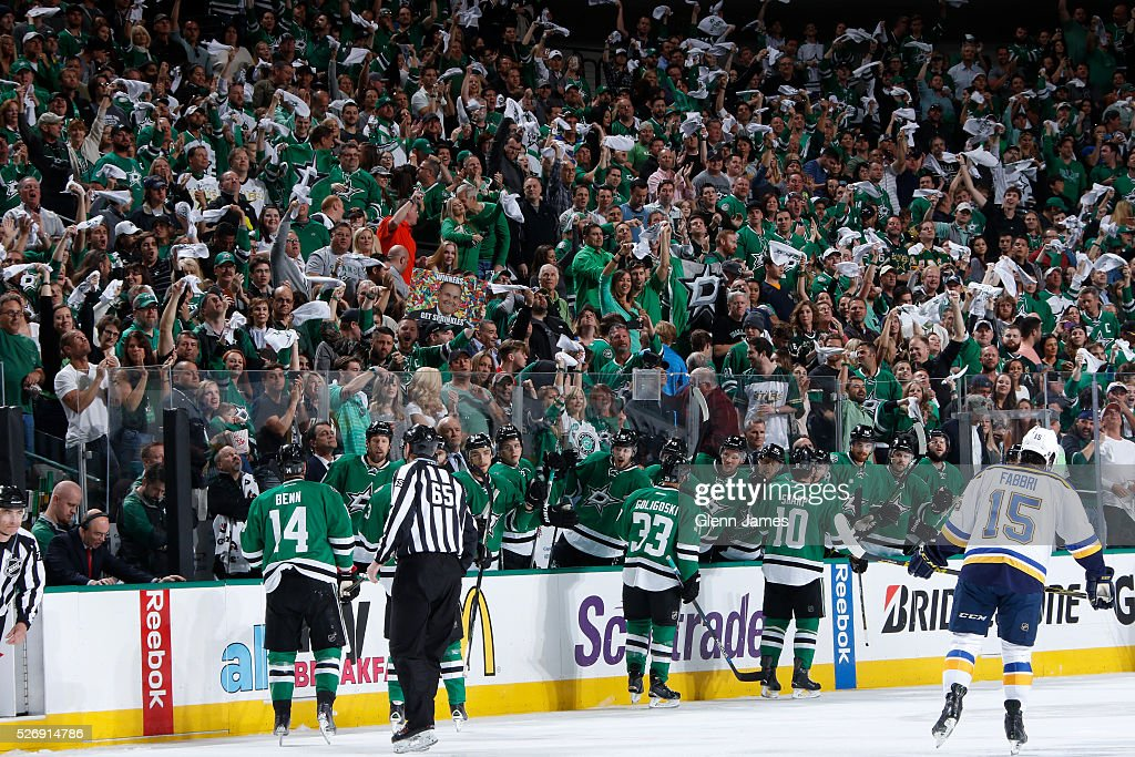 Jamie Benn #14, Alex Goligoski #33 and Patrick Sharp #10 of the Dallas Stars celebrate a goal against the St. Louis Blues in Game Two of the Western Conference Second Round during the 2016 NHL Stanley Cup Playoffs at the American Airlines Center on May 1, 2016 in Dallas, Texas.