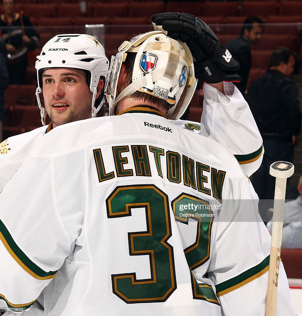<a gi-track='captionPersonalityLinkClicked' href=/galleries/search?phrase=Jamie+Benn&family=editorial&specificpeople=4595070 ng-click='$event.stopPropagation()'>Jamie Benn</a> #14 and <a gi-track='captionPersonalityLinkClicked' href=/galleries/search?phrase=Kari+Lehtonen&family=editorial&specificpeople=211612 ng-click='$event.stopPropagation()'>Kari Lehtonen</a> #32 of the Dallas Stars celebrate the Stars' 3-1 win against the Anaheim Ducks on April 5, 2013 at Honda Center in Anaheim, California.