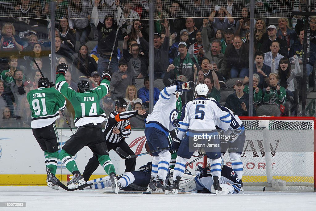 <a gi-track='captionPersonalityLinkClicked' href=/galleries/search?phrase=Jamie+Benn&family=editorial&specificpeople=4595070 ng-click='$event.stopPropagation()'>Jamie Benn</a> #14 and <a gi-track='captionPersonalityLinkClicked' href=/galleries/search?phrase=Tyler+Seguin&family=editorial&specificpeople=6698848 ng-click='$event.stopPropagation()'>Tyler Seguin</a> #91 of the Dallas Stars celebrate a goal against the Winnipeg Jets at the American Airlines Center on March 24, 2014 in Dallas, Texas.