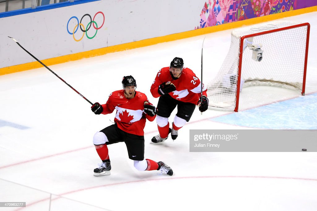 Jamie Benn of Canada celebrates scoring a secondperiod goal against the United States with teammate Corey Perry during the Men's Ice Hockey Semifinal...
