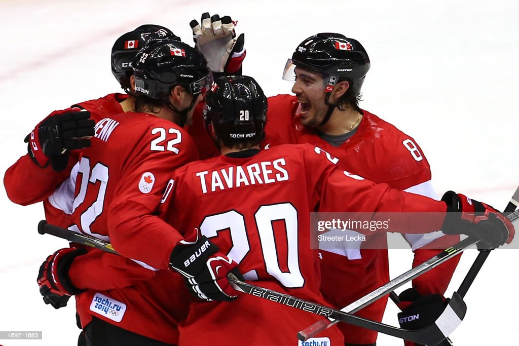 <a gi-track='captionPersonalityLinkClicked' href=/galleries/search?phrase=Jamie+Benn&family=editorial&specificpeople=4595070 ng-click='$event.stopPropagation()'>Jamie Benn</a> #22 of Canada celebrates with his teammates after scoring a goal in the second period against Lars Haugen #30 of Norway during the Men's Ice Hockey Preliminary Round Group B game on day six of the Sochi 2014 Winter Olympics at Bolshoy Ice Dome on February 13, 2014 in Sochi, Russia.
