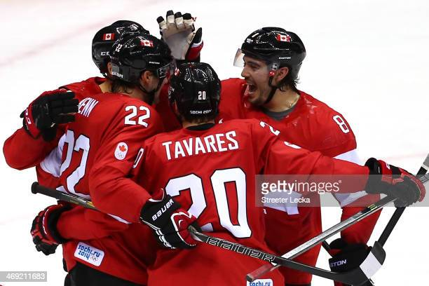 Jamie Benn of Canada celebrates with his teammates after scoring a goal in the second period against Lars Haugen of Norway during the Men's Ice...