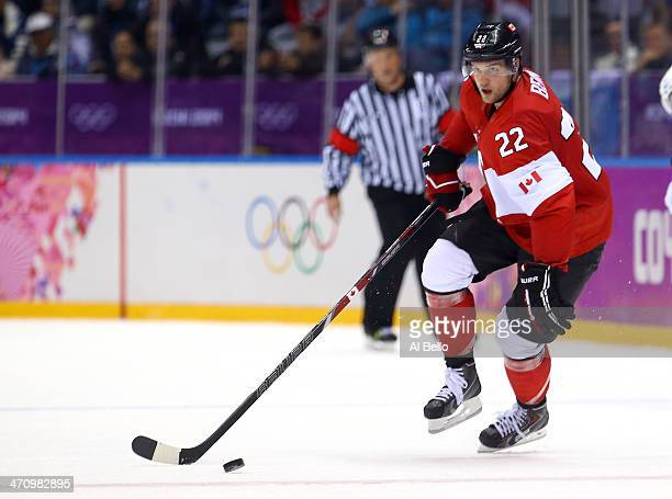 Jamie Benn of Canada handles the puck in the third period against the United States during the Men's Ice Hockey Semifinal Playoff on Day 14 of the...