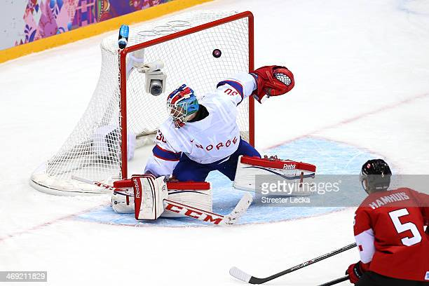 Jamie Benn of Canada scores a goal in the second period against Lars Haugen of Norway during the Men's Ice Hockey Preliminary Round Group B game on...