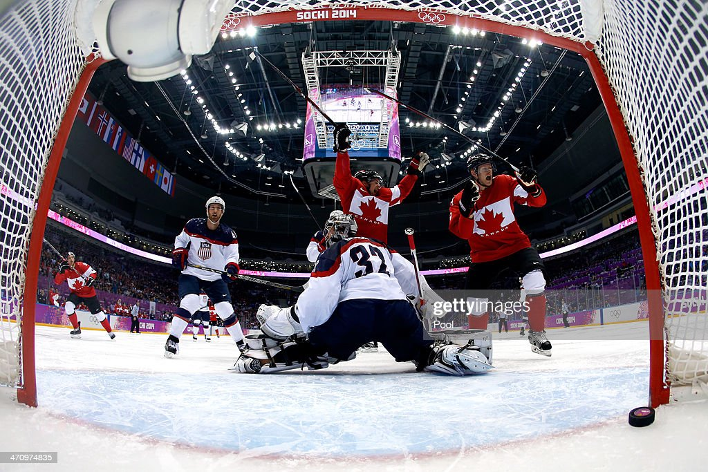 <a gi-track='captionPersonalityLinkClicked' href=/galleries/search?phrase=Jamie+Benn&family=editorial&specificpeople=4595070 ng-click='$event.stopPropagation()'>Jamie Benn</a> #22 of Canada scores a second-period goal against <a gi-track='captionPersonalityLinkClicked' href=/galleries/search?phrase=Jonathan+Quick&family=editorial&specificpeople=2271852 ng-click='$event.stopPropagation()'>Jonathan Quick</a> #32 of the United States during the Men's Ice Hockey Semifinal Playoff on Day 14 of the 2014 Sochi Winter Olympics at Bolshoy Ice Dome on February 21, 2014 in Sochi, Russia.