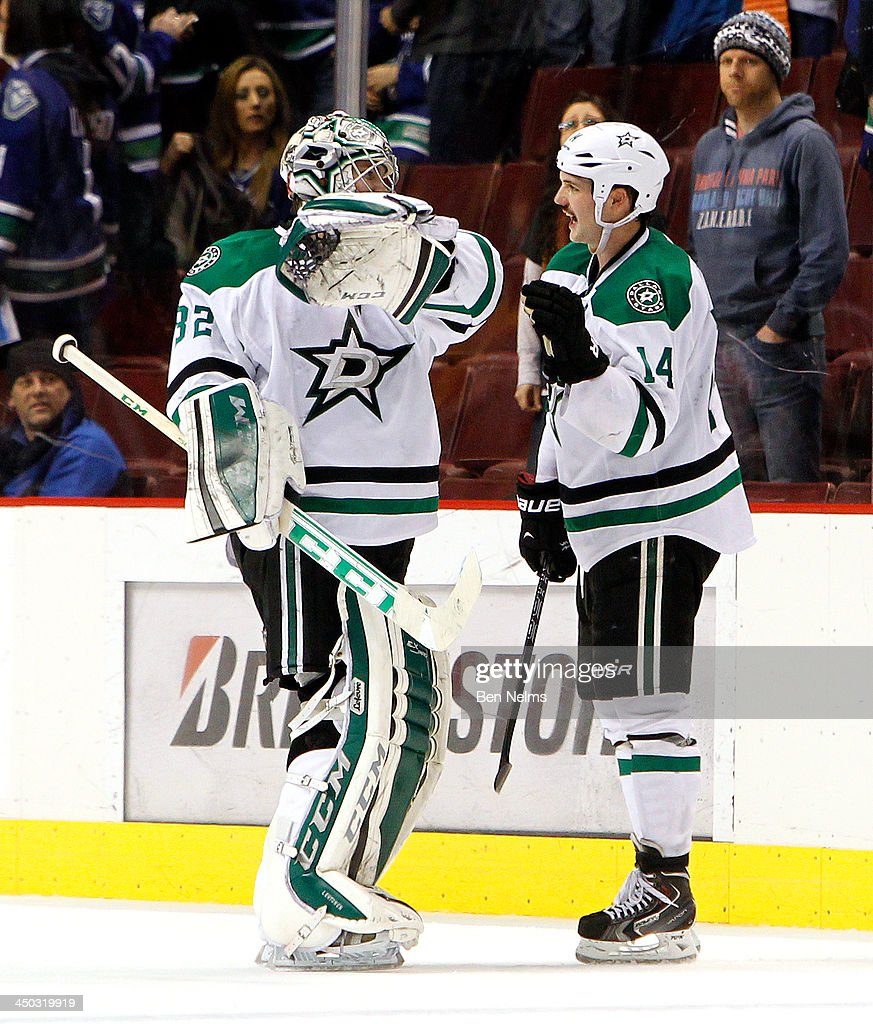 Jamie Benn #14 of the Dallas Stars and goaltender Kari Lehtonen #32 of the Dallas Stars celebrate their win over the Vancouver Canucks after their NHL game at Rogers Arena on November 17, 2013 in Vancouver, British Columbia, Canada.