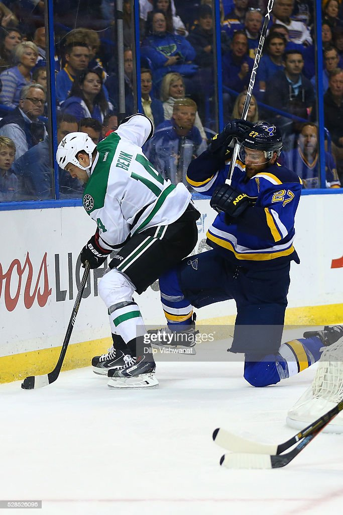 <a gi-track='captionPersonalityLinkClicked' href=/galleries/search?phrase=Jamie+Benn&family=editorial&specificpeople=4595070 ng-click='$event.stopPropagation()'>Jamie Benn</a> #14 of the Dallas Stars beats <a gi-track='captionPersonalityLinkClicked' href=/galleries/search?phrase=Alex+Pietrangelo&family=editorial&specificpeople=4072229 ng-click='$event.stopPropagation()'>Alex Pietrangelo</a> #27 of the St. Louis Blues to the puck in Game Four of the Western Conference Second Round during the 2016 NHL Stanley Cup Playoffs at the Scottrade Center on May 5, 2016 in St. Louis, Missouri.