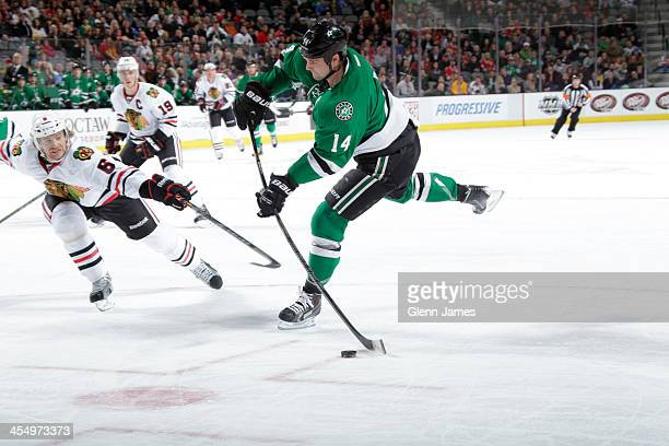 Jamie Benn of the Dallas Stars blasts a shot on goal against Michael Kostka of the Chicago Blackhawks at the American Airlines Center on December 10...