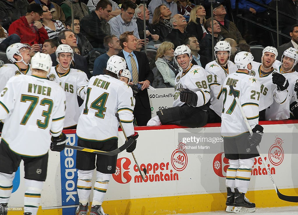 <a gi-track='captionPersonalityLinkClicked' href=/galleries/search?phrase=Jamie+Benn&family=editorial&specificpeople=4595070 ng-click='$event.stopPropagation()'>Jamie Benn</a> #14 of the Dallas Stars celebrates a goal with teammates against the Colorado Avalanche at the Pepsi Center on February 4, 2013 in Denver, Colorado.