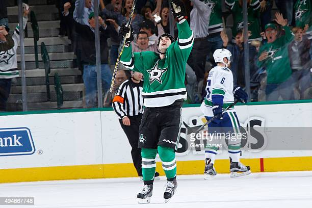 Jamie Benn of the Dallas Stars celebrates an overtime goal against the Vancouver Canucks at the American Airlines Center on October 29 2015 in Dallas...