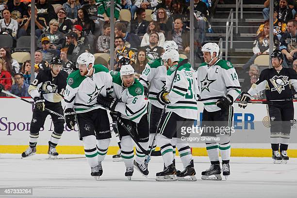 Jamie Benn of the Dallas Stars celebrates his goal with teammates during the third period against the Pittsburgh Penguins at Consol Energy Center on...