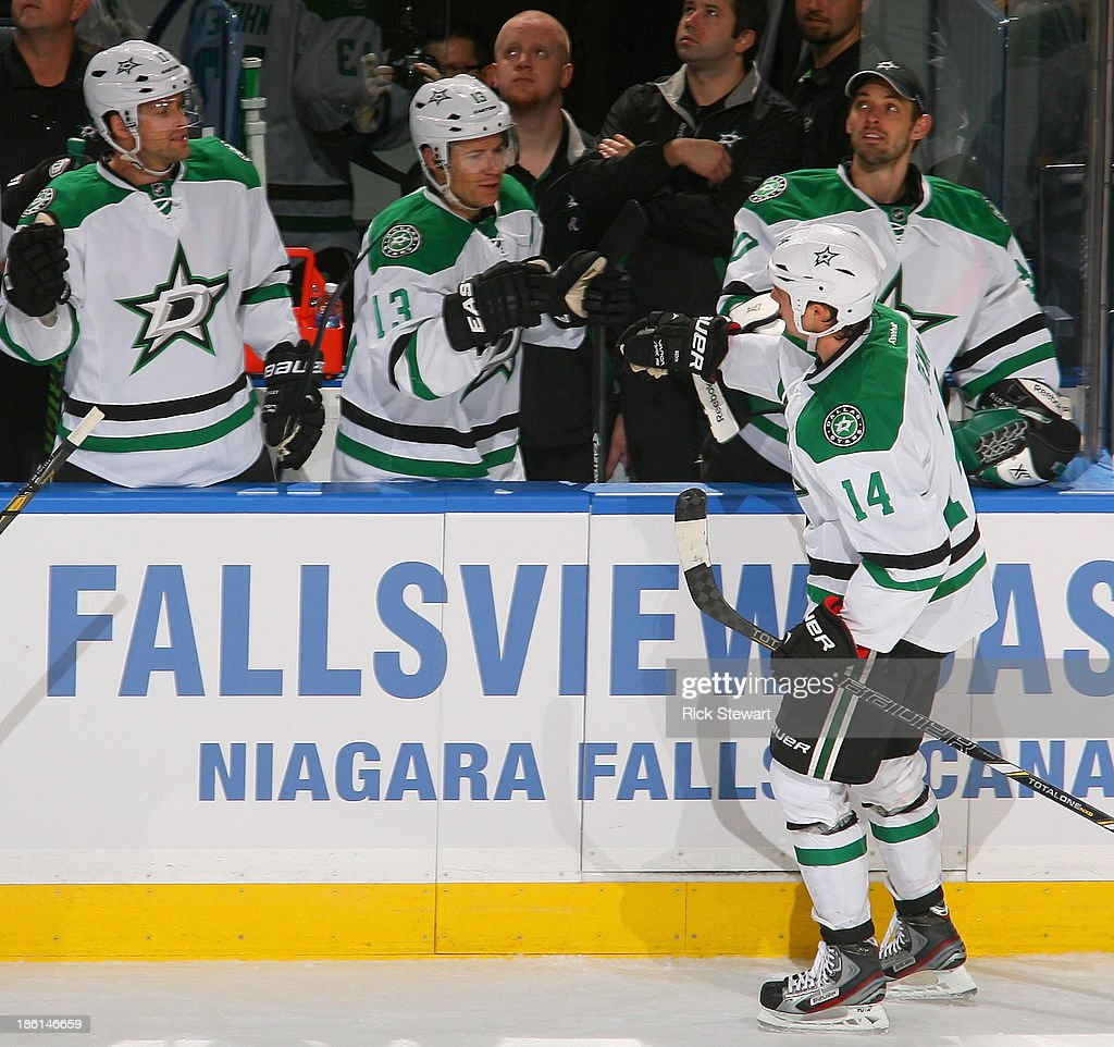 Jamie Benn #14 of the Dallas Stars celebrates with teammates after scoring Dallas' fourth goal against the Buffalo Sabres at First Niagara Center on October 28, 2013 in Buffalo, New York.