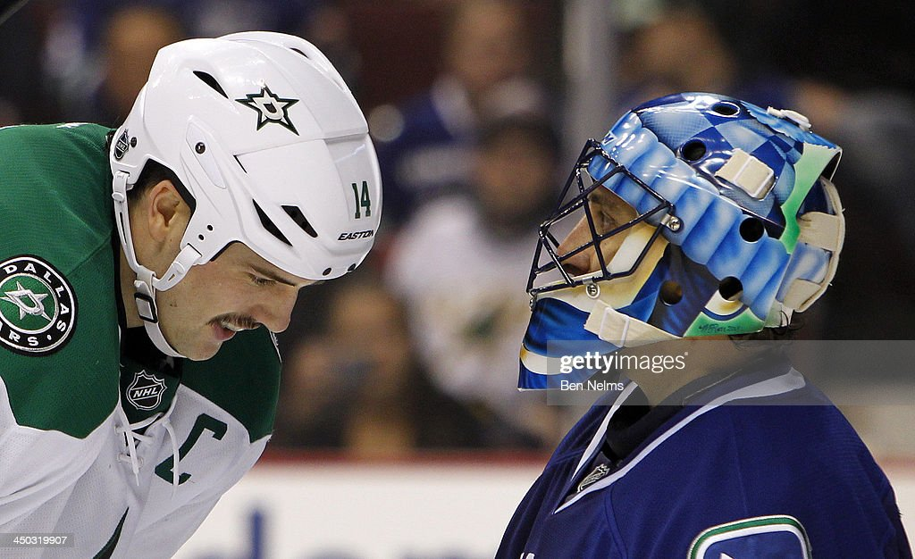 <a gi-track='captionPersonalityLinkClicked' href=/galleries/search?phrase=Jamie+Benn&family=editorial&specificpeople=4595070 ng-click='$event.stopPropagation()'>Jamie Benn</a> #14 of the Dallas Stars chats with goaltender <a gi-track='captionPersonalityLinkClicked' href=/galleries/search?phrase=Roberto+Luongo&family=editorial&specificpeople=202638 ng-click='$event.stopPropagation()'>Roberto Luongo</a> #1 of the Vancouver Canucks during the third period of their NHL game at Rogers Arena on November 17, 2013 in Vancouver, British Columbia, Canada.