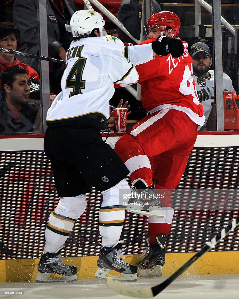 Jamie Benn #14 of the Dallas Stars checks Henrik Zetterberg #40 of the Detroit Red Wings during an NHL game at Joe Louis Arena on January 29, 2013 in Detroit, Michigan.