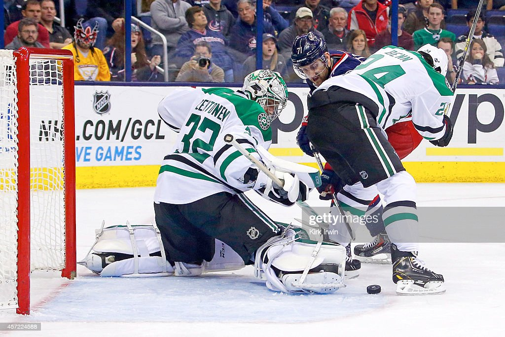 Jamie Benn #14 of the Dallas Stars checks Nick Foligno #71 of the Columbus Blue Jackets as Kari Lehtonen #32 of the Dallas Stars makes a save during the second period on October 14, 2014 at Nationwide Arena in Columbus, Ohio. Dallas defeated Columbus 4-2.