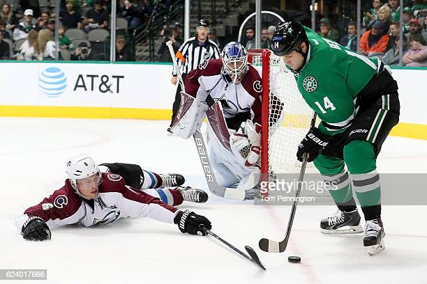 Jamie Benn of the Dallas Stars controls the puck against Erik Johnson of the Colorado Avalanche in the first period at American Airlines Center on...