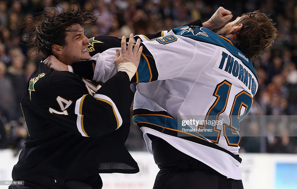 <a gi-track='captionPersonalityLinkClicked' href=/galleries/search?phrase=Jamie+Benn&family=editorial&specificpeople=4595070 ng-click='$event.stopPropagation()'>Jamie Benn</a> #14 of the Dallas Stars fights with <a gi-track='captionPersonalityLinkClicked' href=/galleries/search?phrase=Joe+Thornton&family=editorial&specificpeople=201829 ng-click='$event.stopPropagation()'>Joe Thornton</a> #19 of the San Jose Sharks at American Airlines Center on February 23, 2013 in Dallas, Texas.