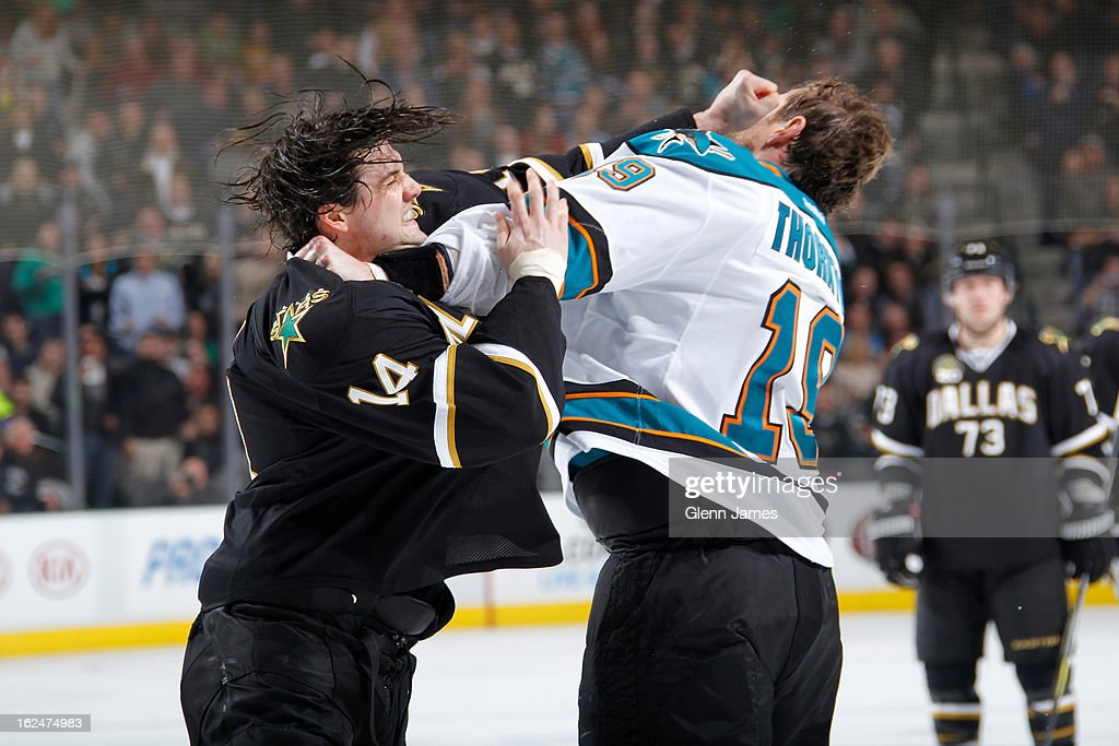 <a gi-track='captionPersonalityLinkClicked' href=/galleries/search?phrase=Jamie+Benn&family=editorial&specificpeople=4595070 ng-click='$event.stopPropagation()'>Jamie Benn</a> #14 of the Dallas Stars gets physical against <a gi-track='captionPersonalityLinkClicked' href=/galleries/search?phrase=Joe+Thornton&family=editorial&specificpeople=201829 ng-click='$event.stopPropagation()'>Joe Thornton</a> #19 of the San Jose Sharks at the American Airlines Center on February 23, 2013 in Dallas, Texas.