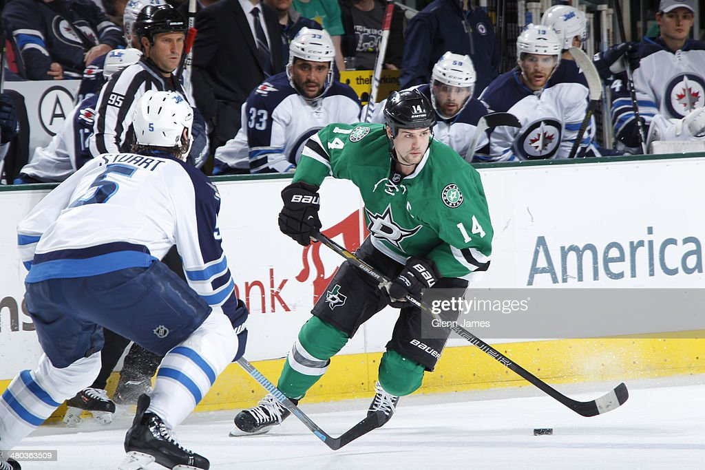<a gi-track='captionPersonalityLinkClicked' href=/galleries/search?phrase=Jamie+Benn&family=editorial&specificpeople=4595070 ng-click='$event.stopPropagation()'>Jamie Benn</a> #14 of the Dallas Stars handles the puck against Mark Stuart #5 of the Winnipeg Jets at the American Airlines Center on March 24, 2014 in Dallas, Texas.