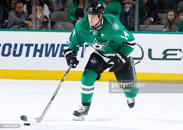 Jamie Benn of the Dallas Stars handles the puck against the Buffalo Sabres at the American Airlines Center on November 21 2015 in Dallas Texas