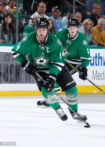 Jamie Benn of the Dallas Stars handles the puck against the Edmonton Oilers at the American Airlines Center on October 13 2015 in Dallas Texas
