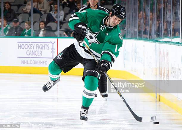 Jamie Benn of the Dallas Stars handles the puck against the Florida Panthers at the American Airlines Center on October 24 2015 in Dallas Texas