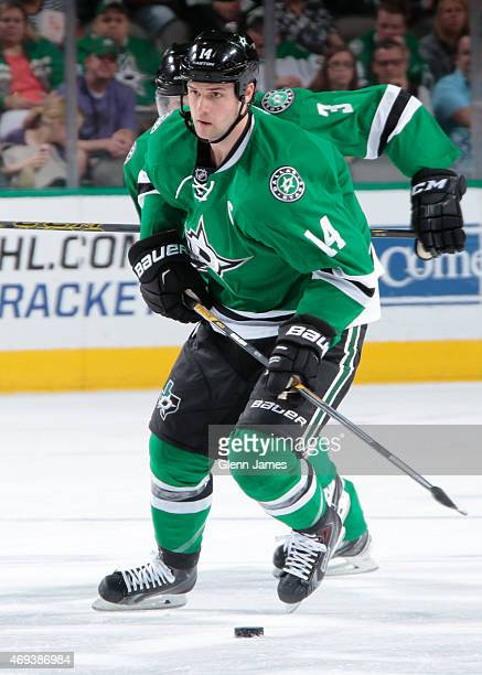 Jamie Benn of the Dallas Stars handles the puck against the Nashville Predators at the American Airlines Center on April 11 2015 in Dallas Texas