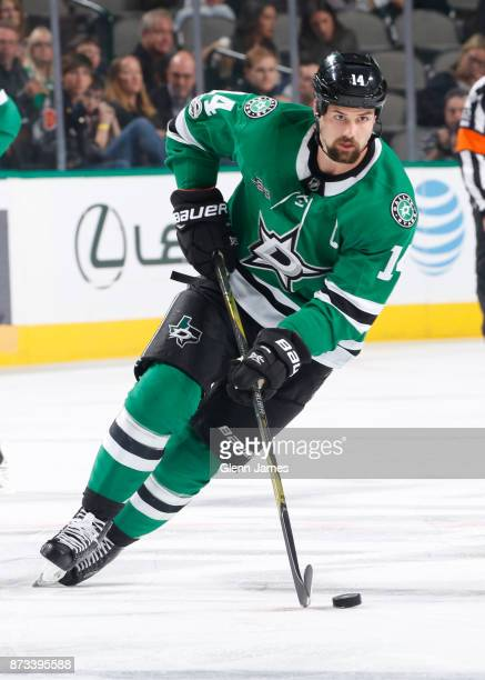Jamie Benn of the Dallas Stars handles the puck against the New York Islanders at the American Airlines Center on November 10 2017 in Dallas Texas