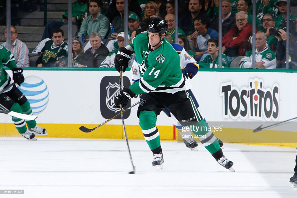 <a gi-track='captionPersonalityLinkClicked' href=/galleries/search?phrase=Jamie+Benn&family=editorial&specificpeople=4595070 ng-click='$event.stopPropagation()'>Jamie Benn</a> #14 of the Dallas Stars handles the puck against the St. Louis Blues in Game One of the Western Conference Second Round during the 2016 NHL Stanley Cup Playoffs at the American Airlines Center on April 29, 2016 in Dallas, Texas.