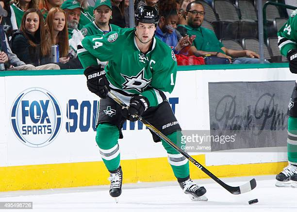 Jamie Benn of the Dallas Stars handles the puck against the Vancouver Canucks at the American Airlines Center on October 29 2015 in Dallas Texas