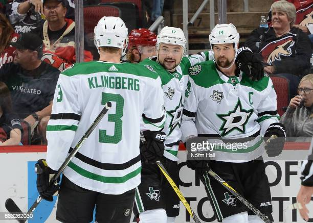 Jamie Benn of the Dallas Stars is congratulated by teammates Devin Shore and John Klingberg after his first period goal against the Arizona Coyotes...