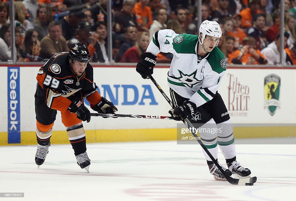 <a gi-track='captionPersonalityLinkClicked' href=/galleries/search?phrase=Jamie+Benn&family=editorial&specificpeople=4595070 ng-click='$event.stopPropagation()'>Jamie Benn</a> #14 of the Dallas Stars is pursued by <a gi-track='captionPersonalityLinkClicked' href=/galleries/search?phrase=Matt+Beleskey&family=editorial&specificpeople=570471 ng-click='$event.stopPropagation()'>Matt Beleskey</a> #39 of the Anaheim Ducks for the puck in the second period of Game One of the First Round of the 2014 NHL Stanley Cup Playoffs at Honda Center on April 16, 2014 in Anaheim, California. The Ducks defeated the Stars 4-3.