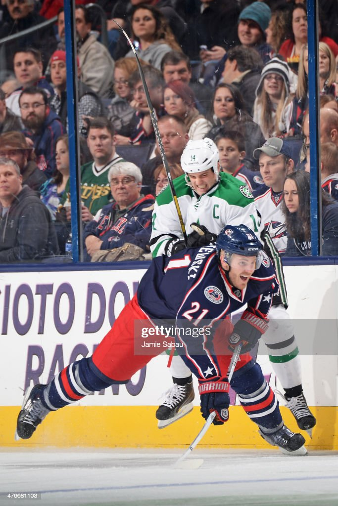 Jamie Benn of the Dallas Stars knocks James Wisniewski of the Columbus Blue Jackets off his feet during the second period on March 4 2014 at...