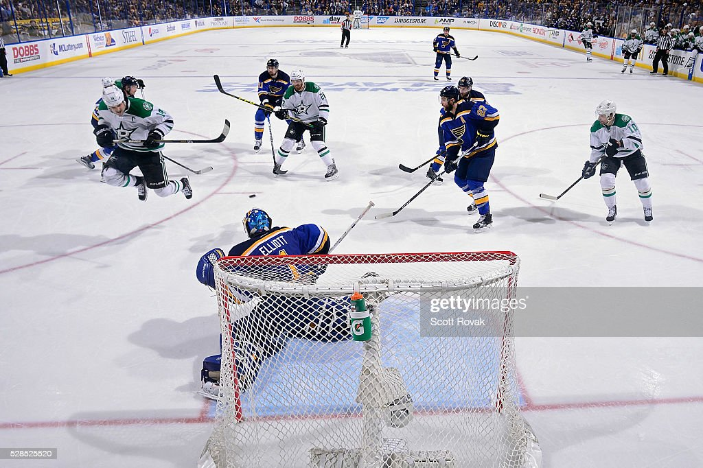 <a gi-track='captionPersonalityLinkClicked' href=/galleries/search?phrase=Jamie+Benn&family=editorial&specificpeople=4595070 ng-click='$event.stopPropagation()'>Jamie Benn</a> #14 of the Dallas Stars leaps over the puck as <a gi-track='captionPersonalityLinkClicked' href=/galleries/search?phrase=Brian+Elliott&family=editorial&specificpeople=687032 ng-click='$event.stopPropagation()'>Brian Elliott</a> #1 of the St. Louis Blues defends the net in Game Four of the Western Conference Second Round during the 2016 NHL Stanley Cup Playoffs at the Scottrade Center on May 5, 2016 in St. Louis, Missouri.